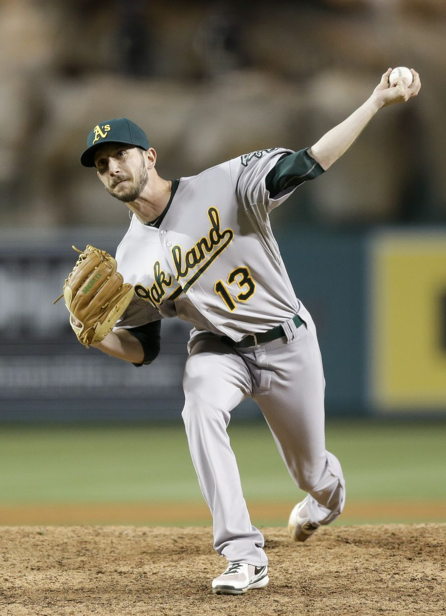 Oakland Athletics relief pitcher Jerry Blevins throws to the Los Angeles Angels during a baseball game in Anaheim, Calif., Wednesday, April 10, 2013. (AP Photo/Chris Carlson)