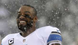 Detroit Lions' Calvin Johnson smiles during warm ups before an NFL football game against the Philadelphia Eagles, Sunday, Dec. 8, 2013, in Philadelphia. (AP Photo/Matt Rourke)