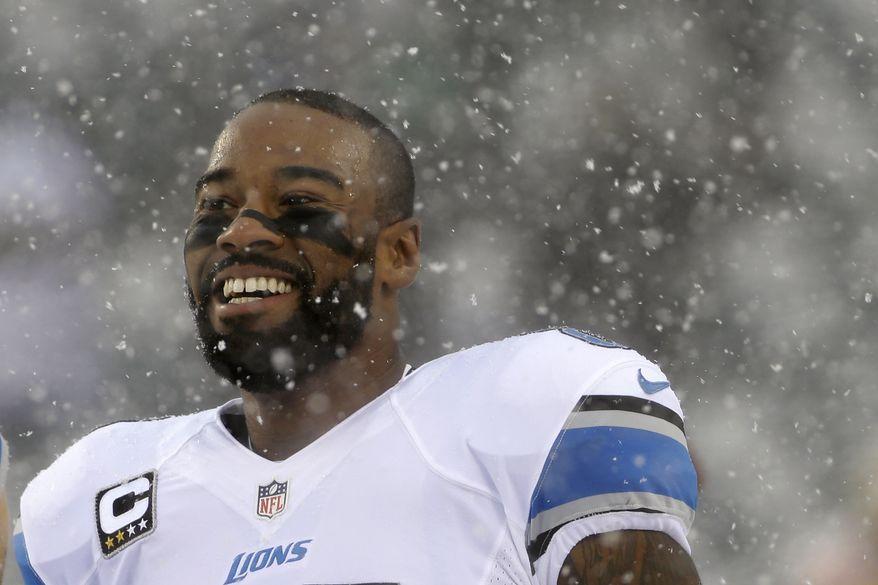Detroit Lions' Calvin Johnson smiles during warm ups before an NFL football game against the Philadelphia Eagles, Sunday, Dec. 8, 2013, in Philadelphia. (AP Photo/Matt Rourke)