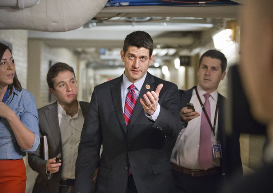 Walking through a basement corridor on Capitol Hill in Washington, Wednesday, Dec. 11, 2013, House Budget Committee Chairman Rep. Paul Ryan, R-Wis., is pursued by reporters on the morning after a budget deal was worked out between Ryan and Senate Budget Committee Chair Sen. Patty Murray, D-Wash. After Ryan presented his plan to the House Republican Conference this morning, Speaker of the House John Boehner, R-Ohio, and GOP leaders signaled support for the deal, which was one of a few key measures left on Congress' to-do list near the end of a bruising year that has produced a partial government shutdown, a flirtation with a first-ever federal default and gridlock on President Obama's agenda. (AP Photo/J. Scott Applewhite)