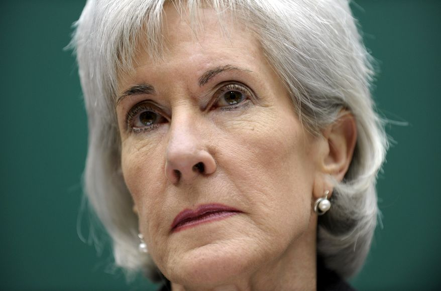 Health and Human Services Secretary Kathleen Sebelius listens as she testifies on Capitol Hill in Washington, Wednesday, Dec. 11, 2013, before the House Energy and Commerce Committee hearing on the implementation failures of the Affordable Care Act. Playing catch-up with a long way to go, President Barack Obama's new health insurance markets last month picked up the dismal pace of signups, the administration reported Wednesday.   (AP Photo/Susan Walsh)