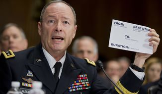 "National Security Agency (NSA) Director Gen. Keith Alexander testifies on Capitol Hill in Washington, Wednesday, Dec. 11, 2013, before the Senate Judiciary Committee hearing on ""Continued Oversight of U.S. Government Surveillance Authorities."" (AP Photo/Manuel Balce Ceneta)"