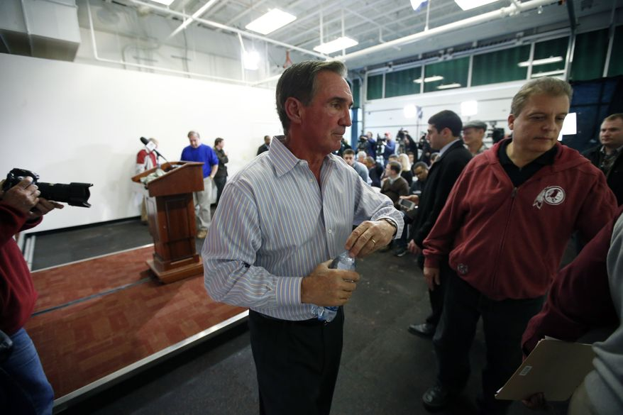 Washington Redskins head coach Mike Shanahan departs after speaking during a media availability at their NFL football training facility, Wednesday, Dec. 11, 2013, in Ashburn, Va. Kirk Cousins will start for the Washington Redskins on Sunday, and Robert Griffin III will be the No. 3 quarterback behind Rex Grossman. (AP Photo/Alex Brandon)