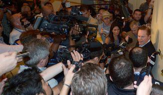 Player agent Scott Boras, right, talks to the media at baseball's winter meetings in Lake Buena Vista, Fla., Wednesday, Dec. 11, 2013.(AP Photo/Phelan M. Ebenhack)