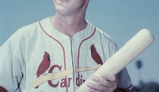 FOR USE AS DESIRED, YEAR END PHOTOS - FILE - In this March 1958 file photo, St. Louis Cardinals' Stan Musial, with bat in hand, poses for a photo during spring training baseball in Florida. Musial, one of baseball's greatest hitters and a Hall of Famer with the Cardinals for more than two decades, died Saturday, Jan. 19, 2013. He was 92. (AP Photo/File)