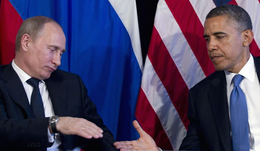 President Obama and Russian President Vladimir Putin (Associated Press) ** FILE **