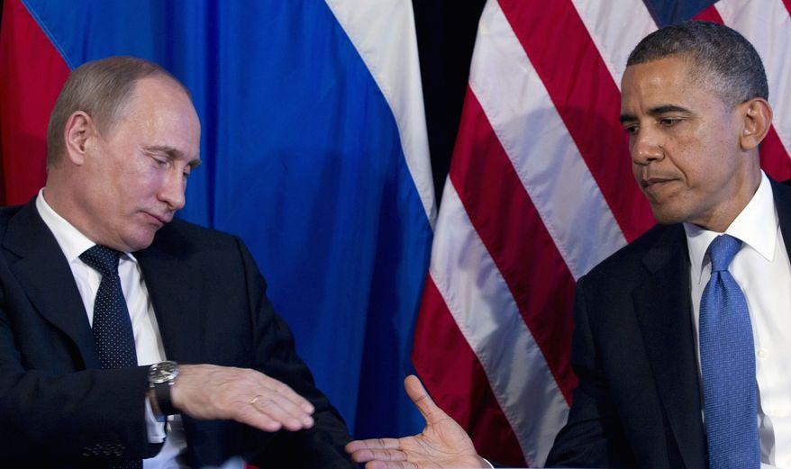 President Obama and Russian President Vladimir Putin (Associated Press) ** FILE **