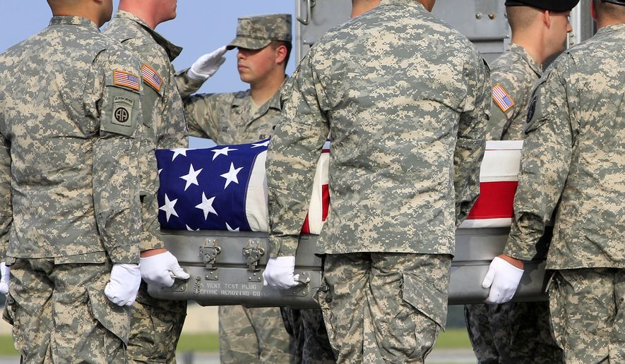 An Army carry team, carries the transfer case containing the remains of Army  Sgt. 1st Class Ricardo D. Young of Rosston, Ark., arriving at Dover Air Force Base, Del. on Saturday, Aug. 31, 2013. The Department of Defense said Young was supporting Operation Enduring Freedom in Afghanistan. (AP Photo/Jose Luis Magana)