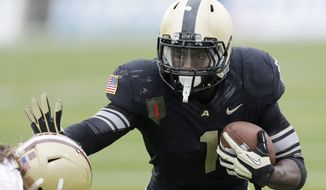 Army running back Raymond Maples (1) runs against Boston College during the second half of an NCAA college football game Saturday, Oct. 6, 2012, in West Point, N.Y. Army won, 34-31. (AP Photo/Mike Groll)