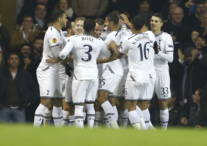 Tottenham's Roberto Soldado (obscured from view) celebrates with teammates after scoring a goal during the Europa League group K soccer match between Tottenham Hotspur and Anzhi Makhachkala at White Hart Lane in London on Thursday, Dec. 12, 2013. (AP Photo/Kirsty Wigglesworth)