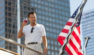 """This film image released by Paramount Pictures shows Leonardo DiCaprio as Jordan Belfort in a scene from """"The Wolf of Wall Street."""" The film was nominated for a Golden Globe for best motion picture, musical or comedy on Thursday, Dec. 12, 2013.  The 71st annual Golden Globes will air on  Sunday, Jan. 12. (AP Photo/Paramount Pictures, Mary Cybulski)"""