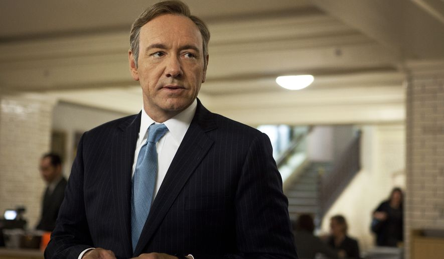 "This image released by Netflix shows Kevin Spacey as U.S. Congressman Frank Underwood in a scene from the Netflix original series, ""House of Cards."" Spacey was nominated for a Golden Globe for best actor in a drama series for his role in the series on Thursday, Dec. 12, 2013.  The 71st annual Golden Globes will air on Sunday, Jan. 12.  (AP Photo/Netflix, Melinda Sue Gordon)"