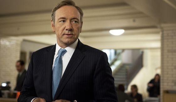 """This image released by Netflix shows Kevin Spacey as U.S. Congressman Frank Underwood in a scene from the Netflix original series, """"House of Cards."""" Spacey was nominated for a Golden Globe for best actor in a drama series for his role in the series on Thursday, Dec. 12, 2013.  The 71st annual Golden Globes will air on Sunday, Jan. 12.  (AP Photo/Netflix, Melinda Sue Gordon)"""