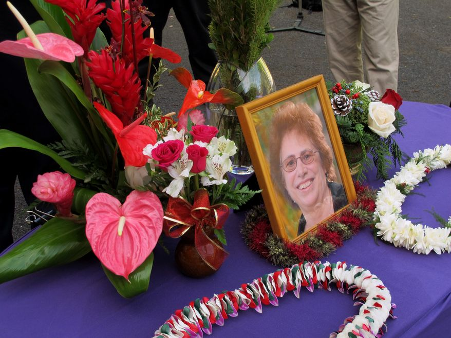 A memorial for Loretta Fuddy, the director of the state Department of Health, is displayed outside the department in Honolulu on Thursday, Dec. 12, 2013. Fuddy died in a plane crash off Molokai on Wednesday. (AP Photo/Audrey McAvoy)