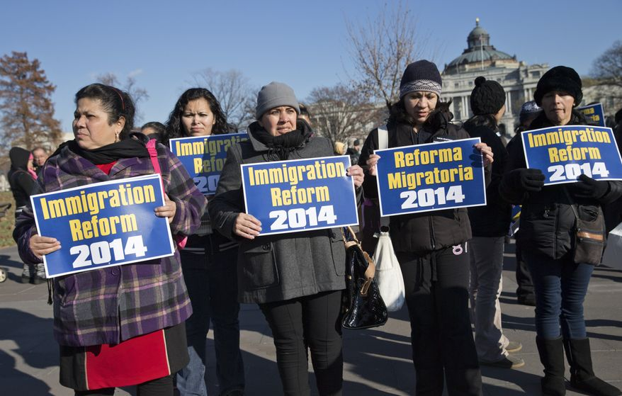 ** FILE ** Immigration activists gather on Capitol Hill in Washington, Thursday, Dec. 12, 2013, as lawmakers speak on the steps of the House of Representatives to appeal for action on an immigration reform bill. A reform bill that could provide a pathway to citizenship for the roughly 11 million immigrants living illegally in the United States has languished as the House Republican leadership has not put the bill to a vote before the holiday recess. (AP Photo/J. Scott Applewhite)