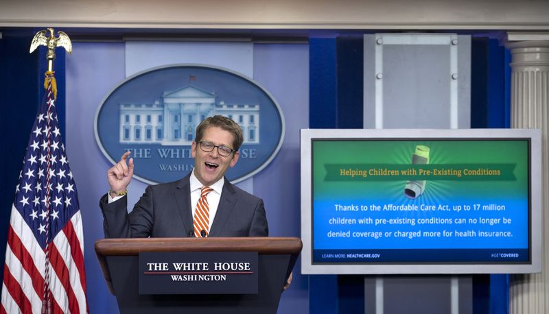White House press secretary Jay Carney gestures as he speaks during his daily news briefing at the White House in Washington, Thursday, Dec. 12, 2013. Carney spoke about preexisting conditions as it pertains to the Affordable care act, unemployment benefits, and other topics. (AP Photo/Carolyn Kaster)