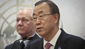 Prof. Ake Sellström, left, head of the U.N. mission to investigate allegations of the use of chemical weapons in the Syria, listens U.N. Secretary Ban Ki-moon makes a statement after receiving a report from the mission on Thursday, Dec. 12, 2013, at U.N. headquarters.  (AP Photo/Bebeto Matthews)
