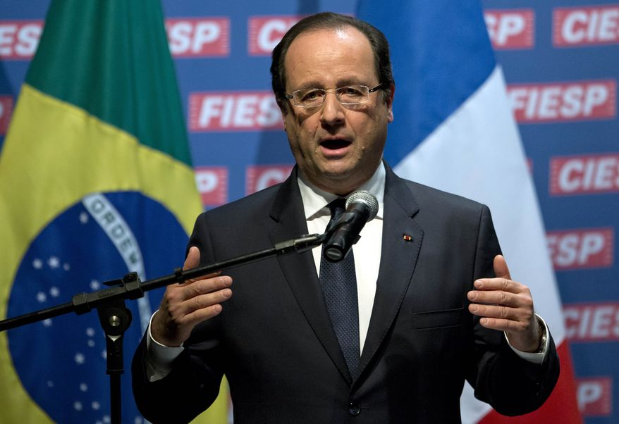 French President Francois Hollande delivers a speech during a meeting with Brazilian President Dilma Rousseff and Brazilian and French businessmen at the Sao Paulo's Industries Federation in Sao Paulo on Friday, Dec. 13, 2013. (AP Photo/Andre Penner)