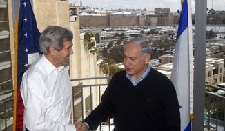 U.S. Secretary of State John Kerry, left, shakes hands with Israeli Prime Minister Benjamin Netanyahu in their meeting at a hotel in Jerusalem on Friday, Dec. 13, 2013. Kerry met with Netanyahu in his latest push for Mideast peace. (AP Photo/Lior Mizrahi, Pool)