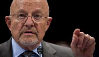 FILE - In this Oct. 29,2013 file photo, Director of National Intelligence James Clapper testifies on Capitol Hill in Washington. The Obama administration will continue the National Security Agency's surveillance programs and cyber command operations under the direction of a single military commander, the first move in advance of what published reports described Friday as limited changes proposed by a task force that deliberated for months in secrecy.  (AP Photo/ Evan Vucci, File)