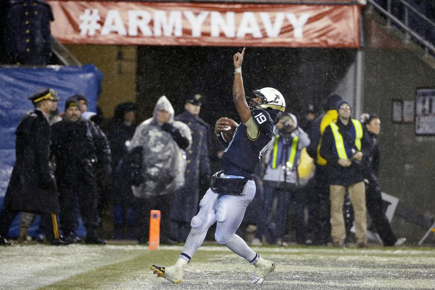 Navy quarterback Keenan Reynolds (19) gestures after scoring a touchdown during the second half of an NCAA college football game against Army, Saturday, Dec. 14, 2013, in Philadelphia. Navy won 34-7. (AP Photo/Matt Slocum)