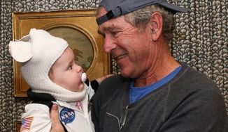 George W. Bush, hipster favorite? This cheerful photo of the former president with his infant granddaughter helped Mr. Bush gain some new admiration among the under-30 crowd. (GEORGE W. BUSH)