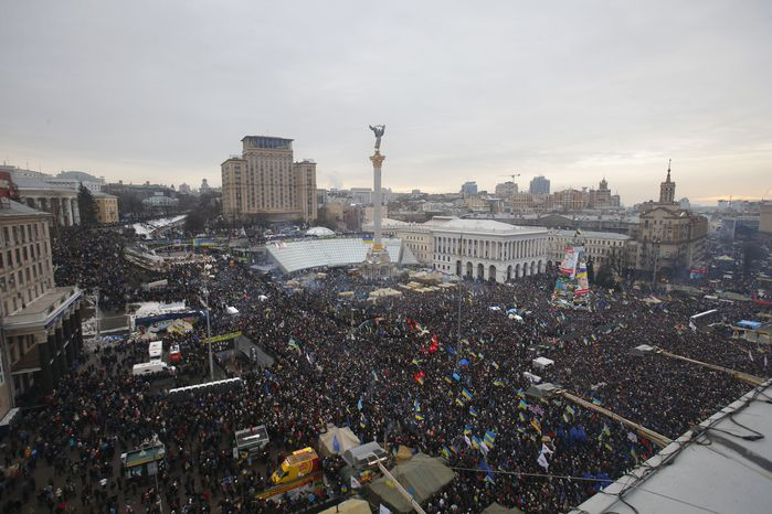 About 200,000 pro-European Union activists rally in Independence Square in Kiev on Sunday, Dec. 15, 2013. (AP Photo/Sergei Grits)