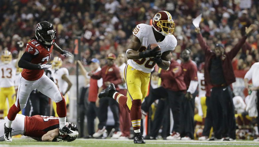 Washington Redskins wide receiver Pierre Garcon (88) makes a catch against Atlanta Falcons cornerback Desmond Trufant (21) during the first half of an NFL football game, Sunday, Dec. 15, 2013, in Atlanta. Moss scored a touchdown on the play. (AP Photo/David Goldman)