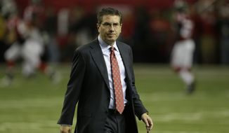 Washington Redskins owner Daniel Snyder walks on the field before the first half of an NFL football game against the Atlanta Falcons, Sunday, Dec. 15, 2013, in Atlanta. (AP Photo/John Bazemore)