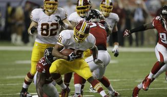 Washington Redskins running back Alfred Morris (46) runs against the Atlanta Falcons during the first half of an NFL football game, Sunday, Dec. 15, 2013, in Atlanta.(AP Photo/John Bazemore)