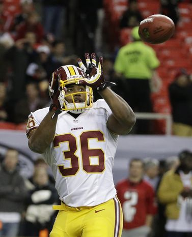 Washington Redskins fullback Darrel Young (36) works out before the first half of an NFL football game against the Atlanta Falcons, Sunday, Dec. 15, 2013, in Atlanta. (AP Photo/David Goldman)