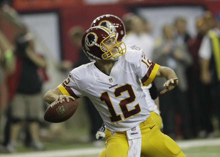 Washington Redskins quarterback Kirk Cousins (12) works against the Atlanta Falcons during the first half of an NFL football game, Sunday, Dec. 15, 2013, in Atlanta. (AP Photo/John Bazemore)