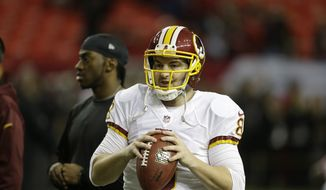 Washington Redskins quarterback Rex Grossman (8) works out before the first half of an NFL football game against the Atlanta Falcons, Sunday, Dec. 15, 2013, in Atlanta. (AP Photo/John Bazemore)
