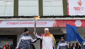 In this photo provided by Olympictorch2014.com and taken on Sunday, Dec. 15, 2013 torch bearer Vadim Gorbenko carries an Olympic torch during the Olympic torch relay during the Olympic torch relay in Kurgan, about 1,750 km (1 087 miles) east of Moscow, Russia. Gorbenko, 73, felt ill and suffered a heart attack while walking back home. (AP Photo/Olympictorch2014.com)