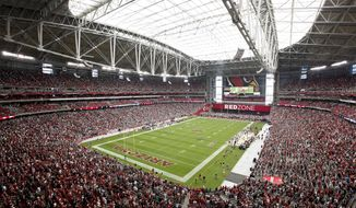 **FILE** Fans get to their feet prior to the start of an NFL football game between the Arizona Cardinals and the Philadelphia Eagles Sunday, Sept. 23, 2012, in Glendale, Ariz. (AP Photo/Rick Scuteri)