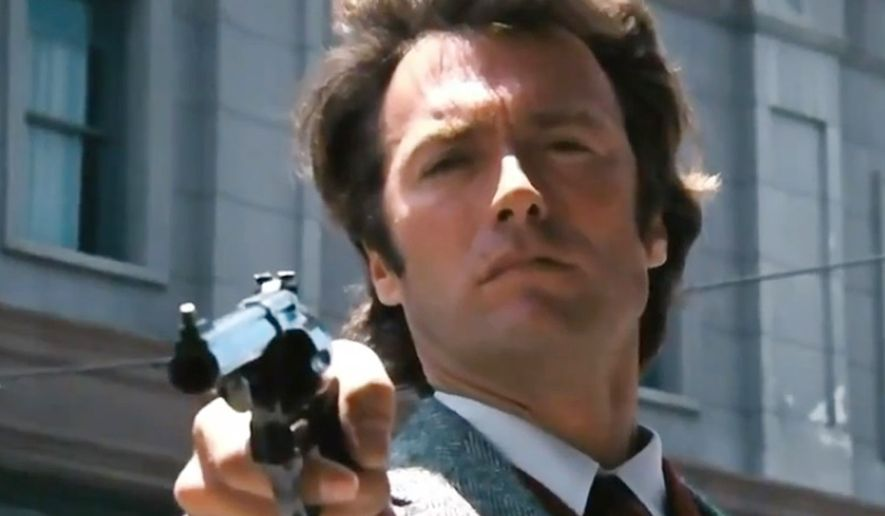 Dirty Harry (Clinton Eastwood) wields his Smith and Wesson .44 magnum revolver. (Warner Bros.) ** FILE **