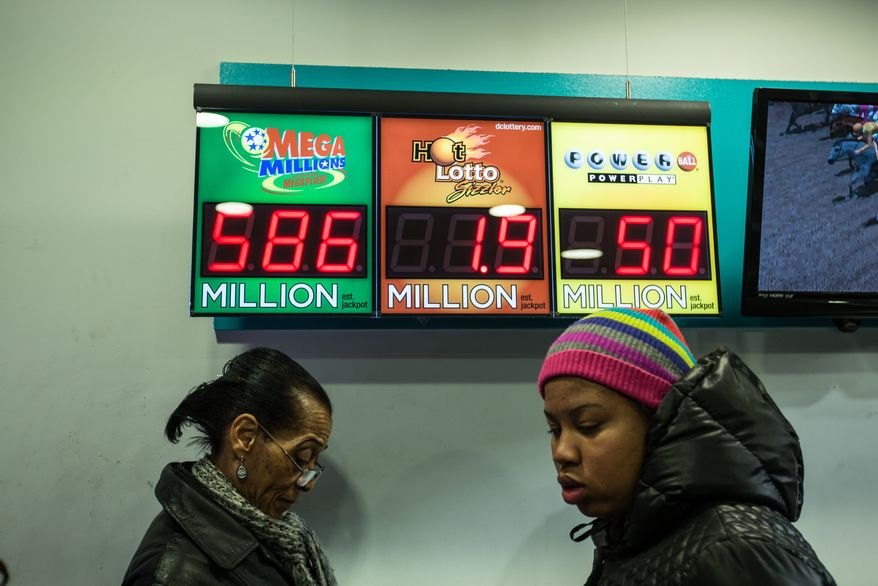 People line up to purchase mega-million lottery tickets for a chance to win the $586 million dollar jackpot, at the DC lottery story at Union Station, in Washington, DC., Monday, December 16, 2013.  (Andrew S Geraci/The Washington Times)