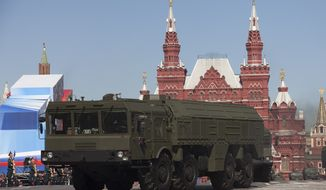 ** FILE ** In this Tuesday, May 7, 2013, file photo, Russian Iskander missiles make their way through Red Square during a rehearsal for the Victory Day military parade in Moscow, Russia. (AP Photo/Alexander Zemlianichenko, File)