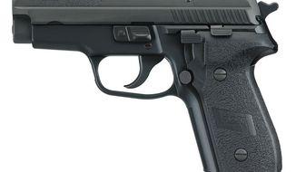 No. 3 Sig Sauer P229 9mm handgun.