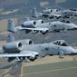 Three A-10C Thunderbolt II aircraft from the 74th and 75th Fighter Squadrons out of Moody Air Force Base, Ga., fly in formation during a training session here March 16, 2010. These A-10 pilots flew in several different formations and also shot flares during their training. (U.S. Air Force photo by Airman 1st Class Benjamin Wiseman) ** FILE **