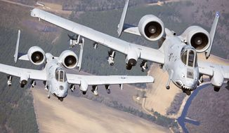 Two A-10C Thunderbolt II aircraft pilots fly in formation during a training exercise March 16, 2010, at Moody Air Force, Ga. Members of the 74th Fighter Squadron performed surge operations to push its support function to the limit and simulate pilots' wartime flying rates. (U.S. Air Force photo by Airman 1st Class Benjamin Wiseman) **FILE**