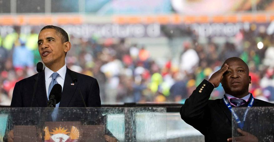 President Obama and sign-language translator Thamsanqa Jantjie during the Nelson Mandela memorial service last week.        Associated Press