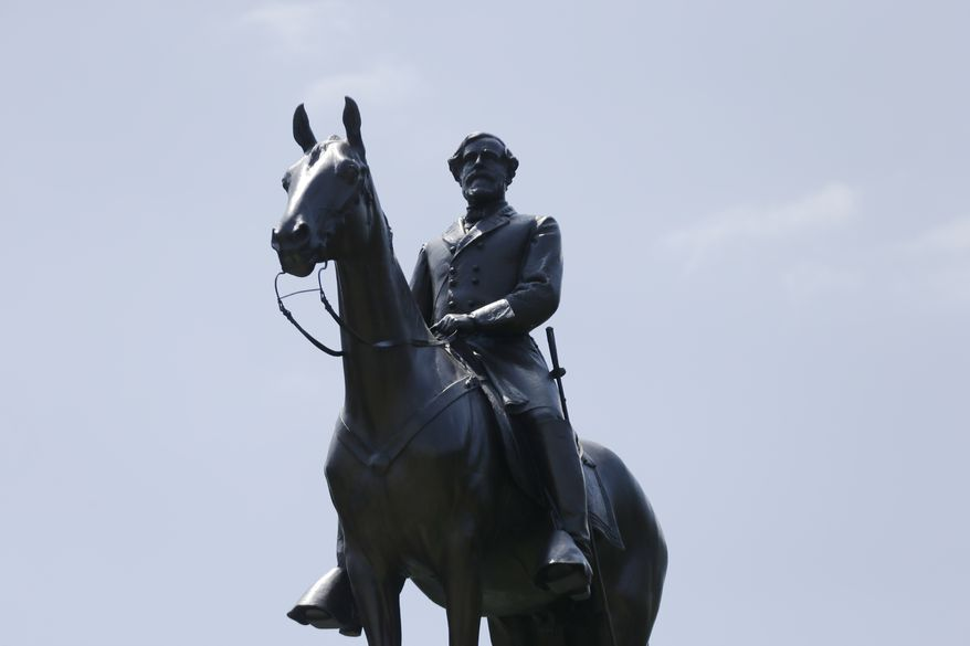 A monument to General Robert E. Lee mounted on his horse Traveller sits atop a ridge held by Confederate troops, above the field of Pickett's Charge, Wednesday, June 5, 2013, in Gettysburg, Pa.  Tens of thousands of visitors are expected for the 10-day schedule of events that begin June 29 to mark the 150th anniversary of the Battle of Gettysburg that took that took place July 1-3, 1863.  (AP Photo/Matt Rourke)