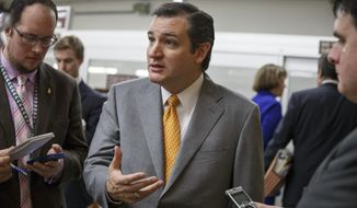 Sen. Ted Cruz, R-Texas speaks with reporters on Capitol Hill in Washington, Tuesday, Dec. 17, 2013, after a bipartisan budget compromise cleared a procedural hurdle in the Senate, advancing past a filibuster threshold on a 67-33 vote that ensures the measure will pass the Democratic-led chamber no later than Wednesday and head to the White House to be signed into law. When enacted, the measure would ease for two years some of the harshest cuts to agency budgets required under automatic spending curbs commonly known as sequestration. (AP Photo/J. Scott Applewhite)
