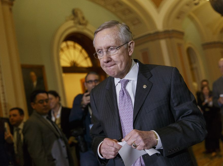 Senate Majority Leader Harry Reid of Nev. takes questions on the unfinished work of the Senate, following a Democratic policy luncheon, Tuesday, Dec. 17, 2013, on Capitol Hill in Washington.  (AP Photo/J. Scott Applewhite)