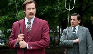 "Will Ferrell as Ron Burgundy, left, and Steve Carell as Brick Tamland in a scene from ""Anchorman 2: The Legend Continues."" (AP Photo/Paramount Pictures, Gemma LaMana)"