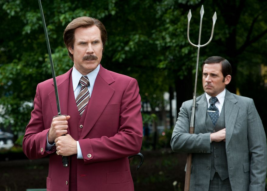 """Will Ferrell as Ron Burgundy, left, and Steve Carell as Brick Tamland in a scene from """"Anchorman 2: The Legend Continues."""" (AP Photo/Paramount Pictures, Gemma LaMana)"""