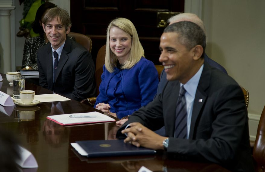 President Barack Obama meets with technology executives in the Roosevelt Room of the White House in Washington,Tuesday, Dec. 17, 2013. From left are, Mark Pincus, founder, Chief Product Officer & Chairman, Zynga,  Marissa Mayer, President and CEO, Yahoo!, and Obama. (AP Photo/ Evan Vucci)