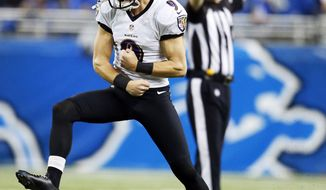 Baltimore Ravens kicker Justin Tucker (9) celebrates after his 61-yard field during the fourth quarter of an NFL football game against the Detroit Lions in Detroit, Monday, Dec. 16, 2013. (AP Photo/Rick Osentoski)