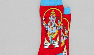 "Urban Outfitters removed their controversial ""Lord Ganesh"" socks (pictured) and issued an apology to Hindus on Monday. (Image: Twitter, Urban Outfitters)"